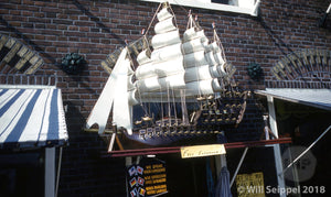 Vintage Ship Model above Shop Entrance