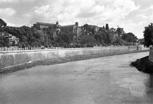Unknown River Running Along a City and Buildings in WWII Italy