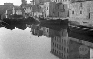 Traditional Houses and Gondolas Reflected on the Smooth Crystaline Waters of Venice, Italy 1940s
