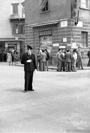 Young Police Officer Monitoring the Busy Crossroads of an Unknown Street in Italy, 1940s