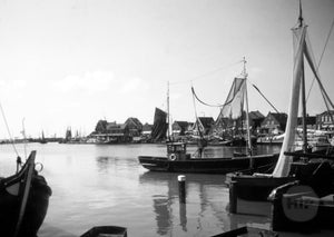 Dutch Fishing Boats Stationed at a Bustling Harbor in Holland