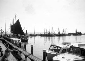 Dutch Ships and Express Boats Stationed Along a Small Harbor in Holland, 1950s