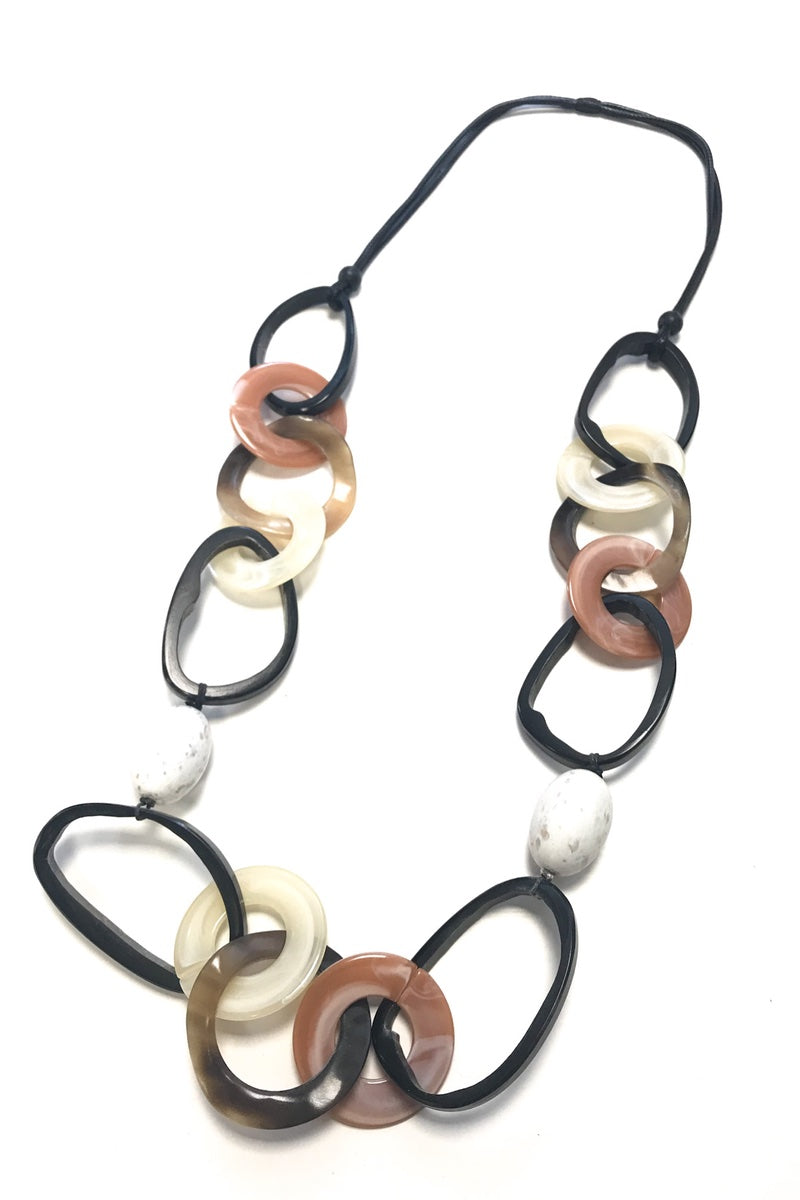 long loop necklace earthy tones nude coral eggshell