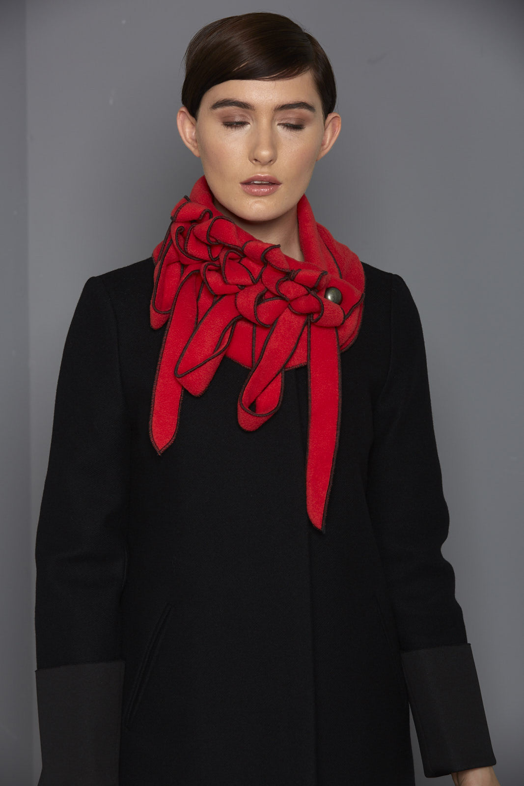 bright red scarf with black stitching