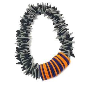 layer disc necklace orange and blue grey shapes