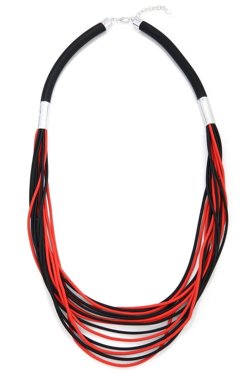 unusual red and black necklace.