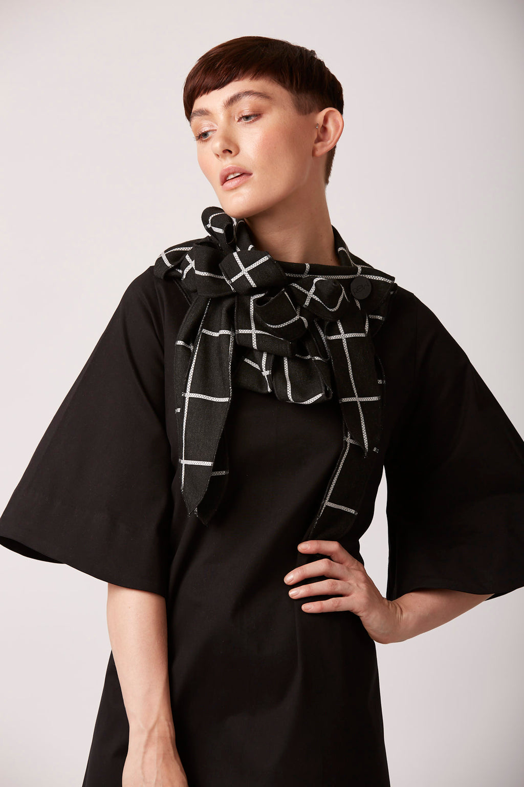 Grid patterned scarf by rew clothing