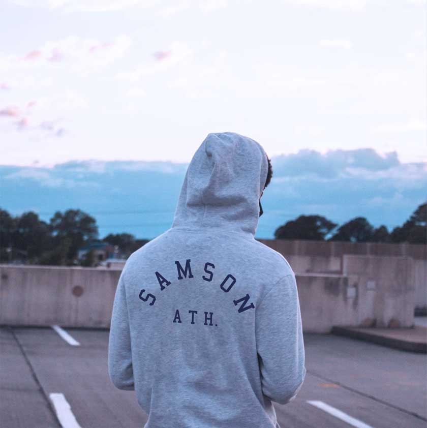 woman wearing gym hoodie from Samson Athletics