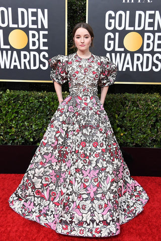 Actress Kaitlyn Denver on the red carpet wearing a voluminous floral print Valentino gown