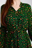 A close up of the front of the green, orange and black animal print dress, showing the button front to the waist