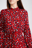 A close up of the red animal print dress, showing the buttons on the front, going to the waist