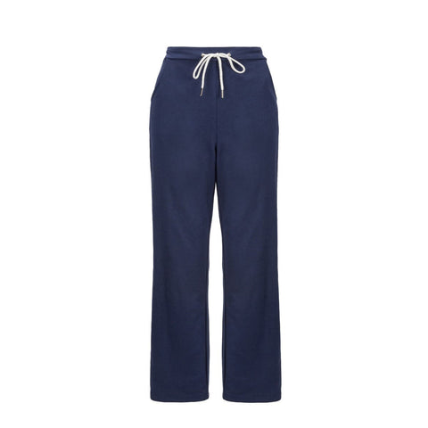 A 'flat lay' image of the blue jogging bottoms, shown from the front