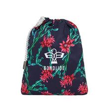 Load image into Gallery viewer, Wonderland Swim shorts by Bondi Joe Carry Bag shot