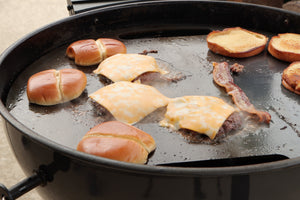 The carbon steel Plancha from SnS Grills provides a smooth, flat top cooking surface with excellent thermal conductivity, which is perfect for smash burgers, Philly cheesesteaks, Hibachi style meals, breakfast and much more. Once seasoned, the natural non-stick cooking surface makes the Plancha easy to cook with and also very easy to clean and maintain.