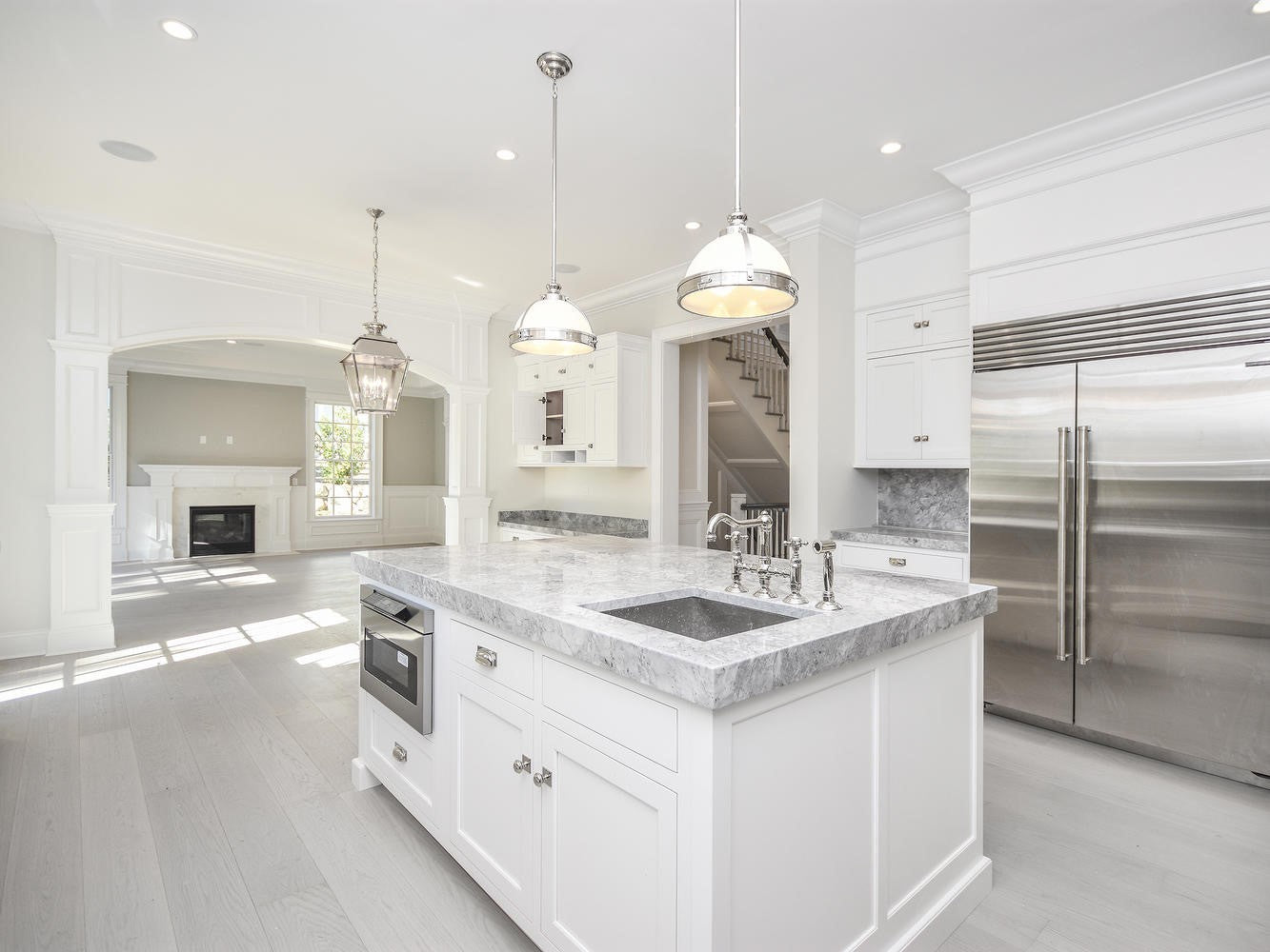 Beautiful kitchen with white wood flooring from Rivafloors.
