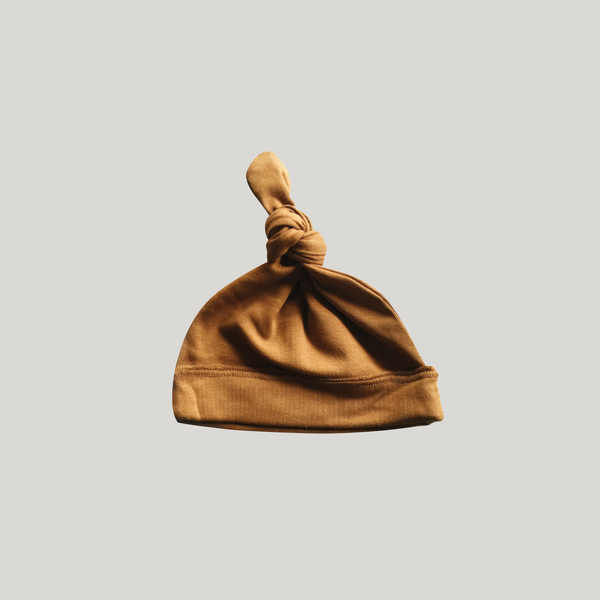 Knotted Hat. Brass