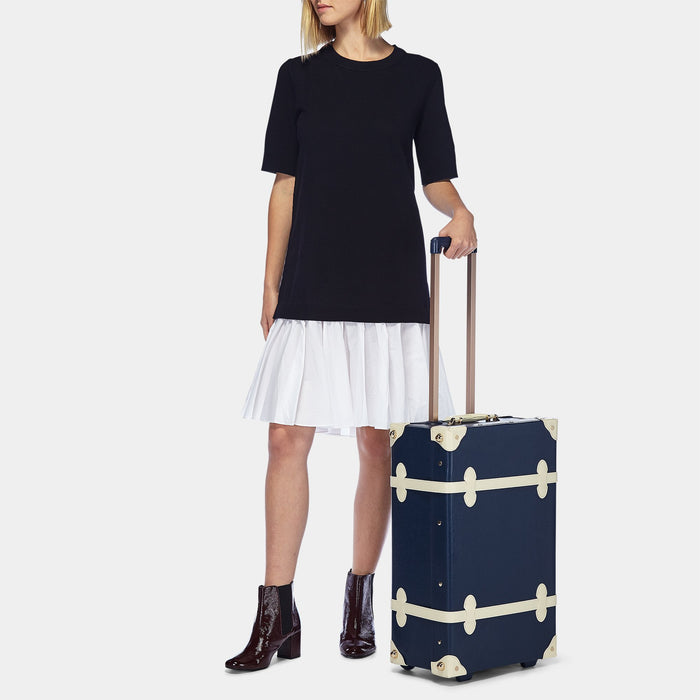 The Entrepreneur Stowaway in Navy - Vintage-Inspired Luggage - Exterior Front with Model