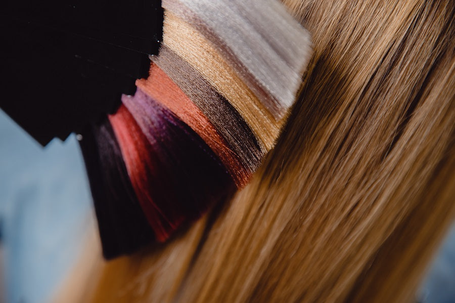 Hair extension color palette next to blonde hair