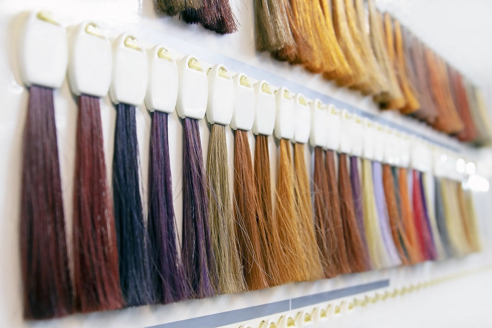 Hair extension color samples on wall