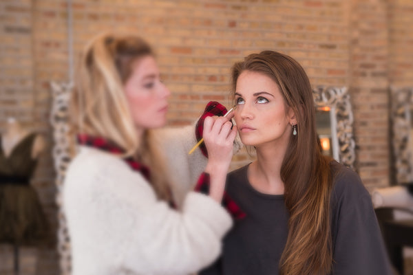 Female Applying Makeup on Model