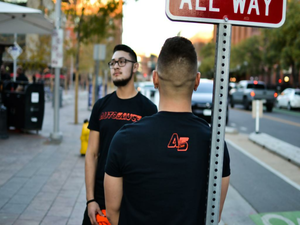 Jeremy of Autosauce, the Honda YouTube channel, wearing a black t-shirt in downtown Denver, CO.