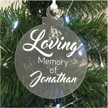 Load image into Gallery viewer, Exclusive to 'The Lovely Gift Group'. A bauble shaped 'In Loving Memory Of' Christmas tree ornament. Clear acrylic with white text. Alternative angle.