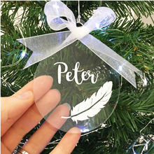 Load image into Gallery viewer, Personalised Memorial Christmas Tree Decoration, Clear Acrylic Hanging Bauble, White Feather and Name. Alternative view - hand presents.