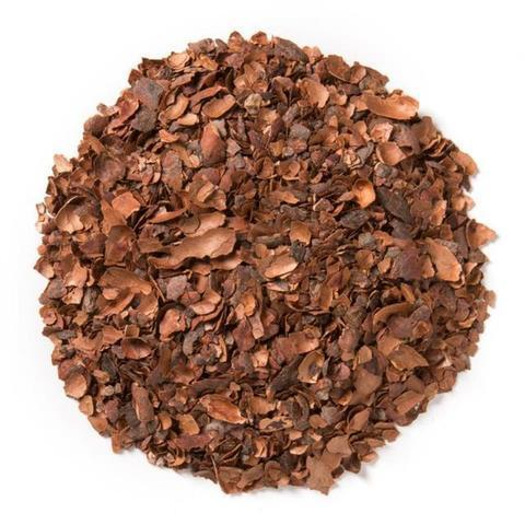 cacao husks formed into a circle flatlay white background