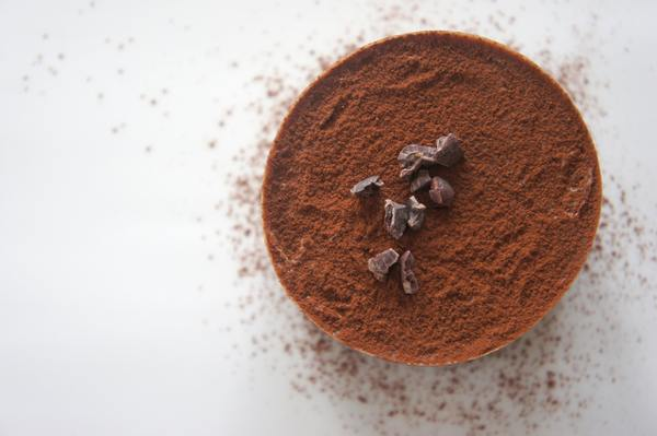 cacao powder with chocolate pieces top view