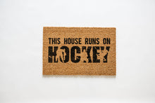 Load image into Gallery viewer, This House Runs On HOCKEY Welcome Doormat