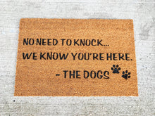 Load image into Gallery viewer, No Need to Knock We Know You're Here. - The Dogs Welcome Door Mat