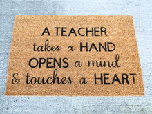 Load image into Gallery viewer, A Teacher Takes A HAND OPENS A Mind & Touches A HEART Doormat