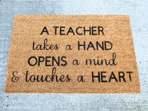 A Teacher Takes A HAND OPENS A Mind & Touches A HEART Doormat