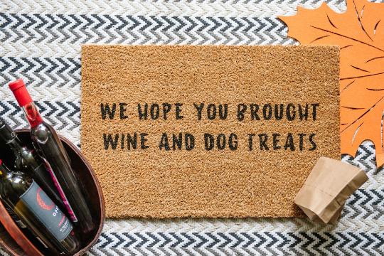 We Hope You Brought Wine And Dog Treats Welcome Doormat