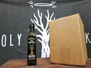 A bottle of smoked olive oil next to a cardboard box
