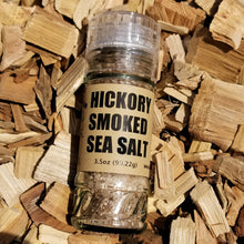 Load image into Gallery viewer, Hickory Smoked Sea Salt in a jar lying on hickory chips