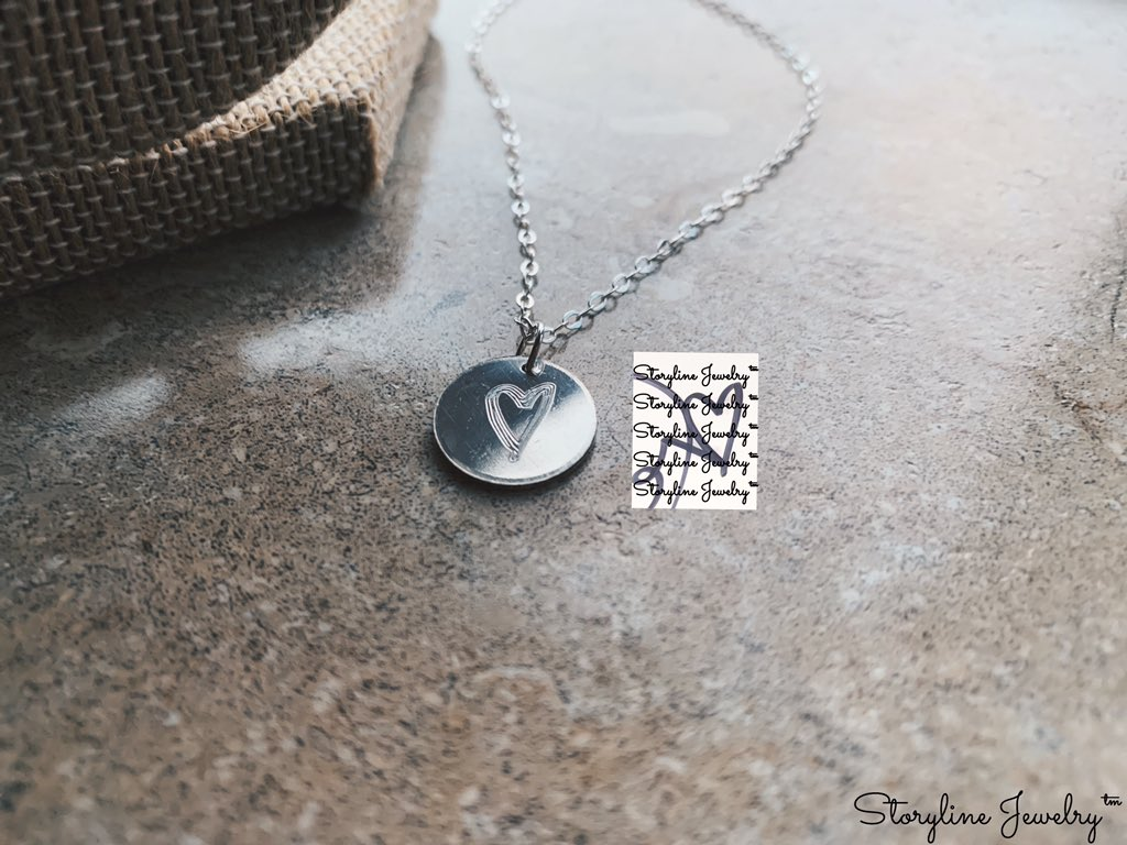 Handwritten: The Disc Necklace