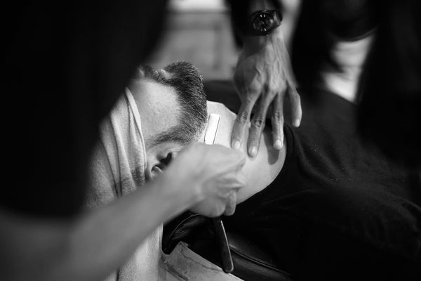 barber trimming a beard