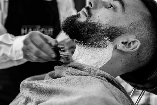 man getting a beard trim
