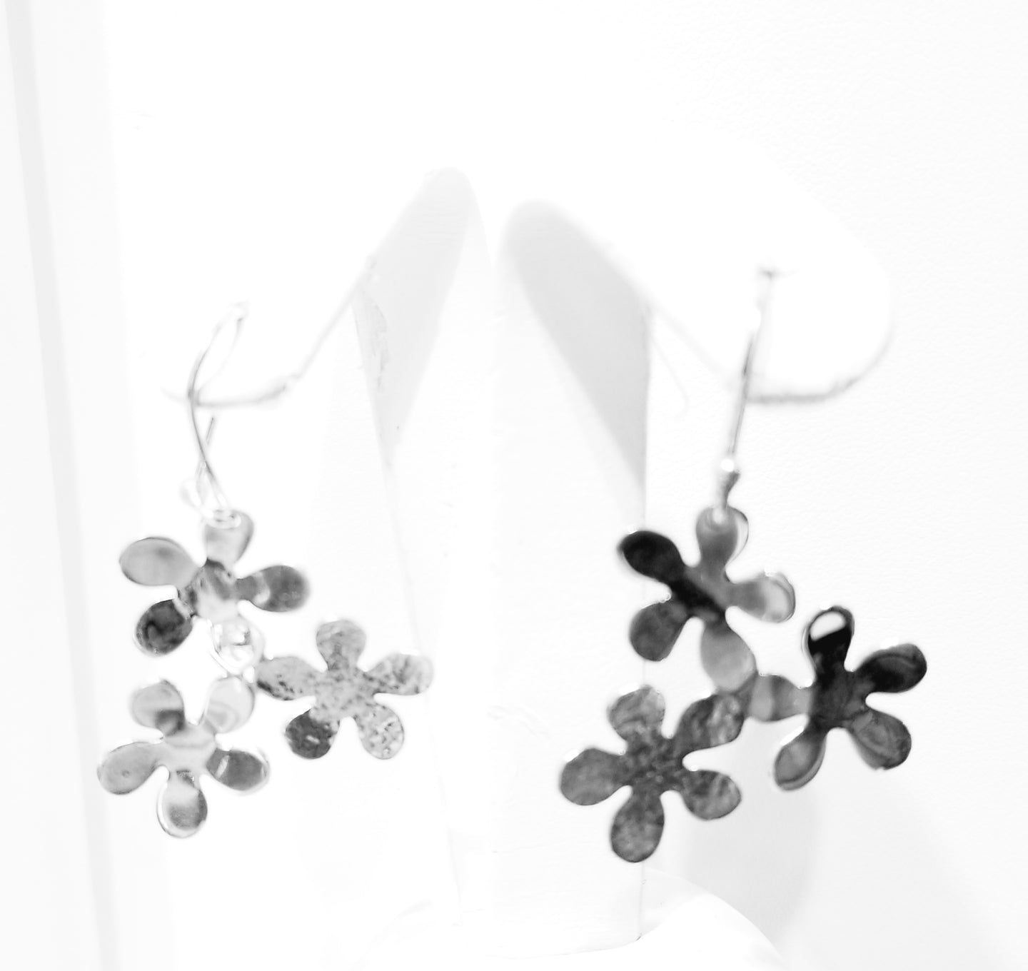 Silver earrings (part of the set)