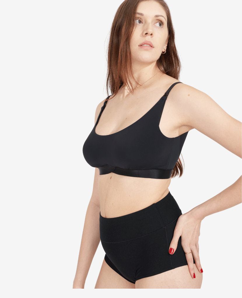 Soft bra designed with a lactation consultant for breast health and ease of nursing. Model wearing M in Black, and typically wears a size 32C.