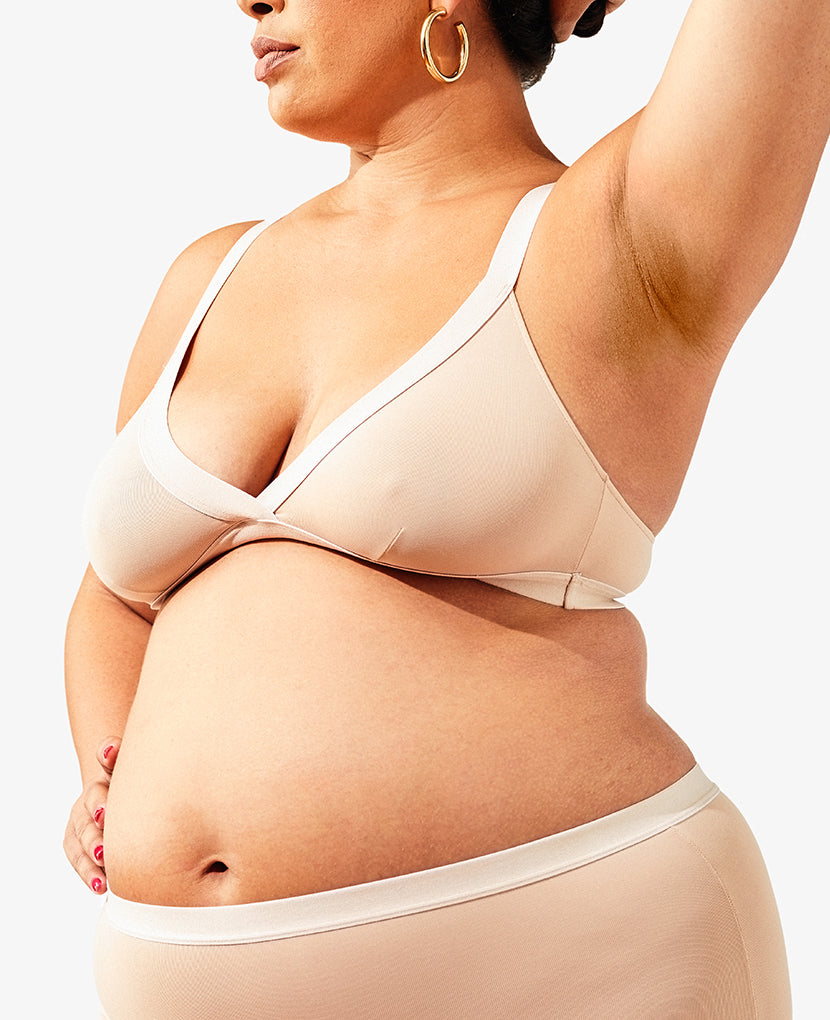 Model wearing a size L almond Insider Bra, and usually wears a size 40D.
