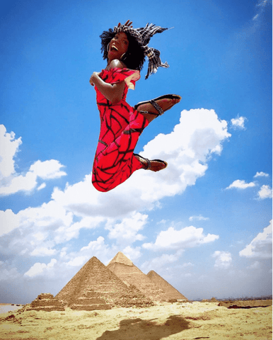 Black Girl Jumping in Front of Pyramids