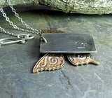 Butterfly Dance - sterling silver, brass and iolite pendant