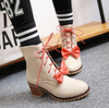 Bowknot Heeled Booties In Cream