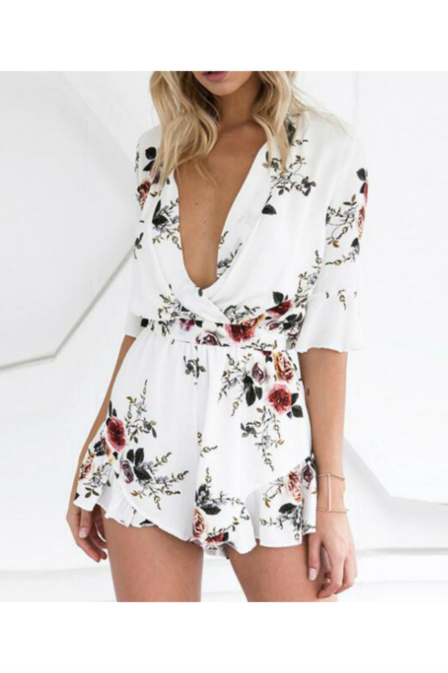 1fed9a3170a1 ... White Floral Romper. Touch to zoom