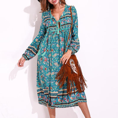 Bohemian floral print dress with long sleeves and fringe