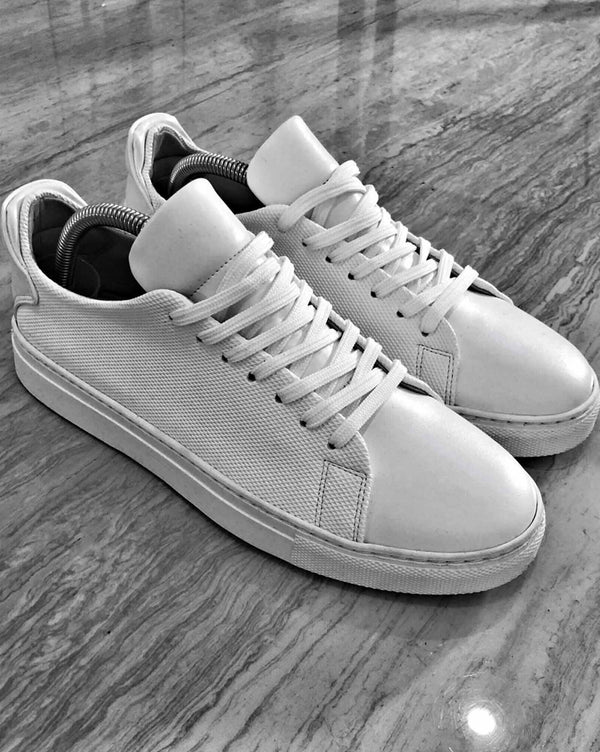 Chaussures basket blanches aspect cuir tendances homme