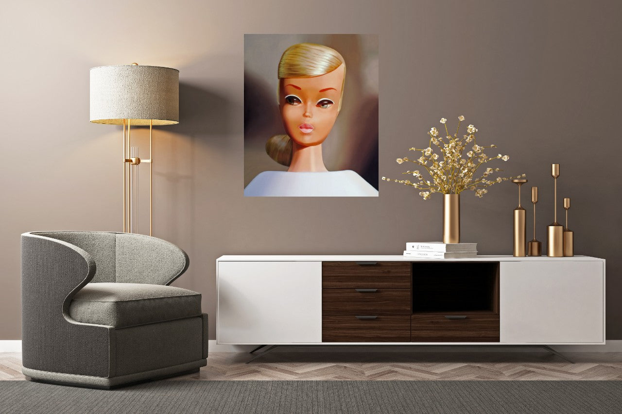 Platinum Swirl Barbie by Judy Ragagli hanging in front of a modern credenza.