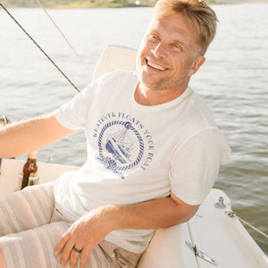 Man on boat wearing funny sarcastic Whatever Floats Your boat t-shirt from Shirty Store